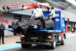 The McLaren MP4-29 of Kevin Magnussen, McLaren is recovered back to the pits on the back of a truck