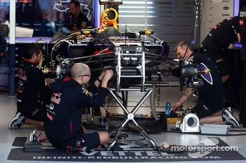 The Red Bull Racing RB10 of Sebastian Vettel, Red Bull Racing is prepared by mechanics in the pits