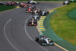Nico Rosberg, Mercedes AMG F1 W05 leads at the start of the race as Kamui Kobayashi, Caterham CT05 and Felipe Massa, Williams FW36 crash out
