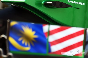 The Caterham CT05 carries a tribute to flight MH370