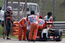 Romain Grosjean, Lotus F1 Team stops on track