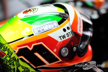The helmet of Sergio Perez, Sahara Force India F1 with a tribute to flight MH370