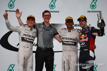 Race winner Lewis Hamilton, Mercedes AMG F1 second place Nico Rosberg, Mercedes AMG F1 and third place Sebastian Vettel, Red Bull Racing