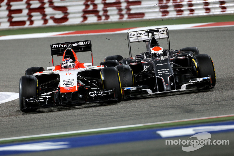 Jules Bianchi, Marussia F1 Team  and Adrian Sutil, Sauber F1 Team  06