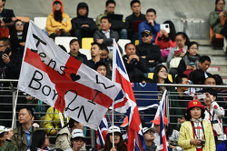 Jenson Button, McLaren fans and flags.