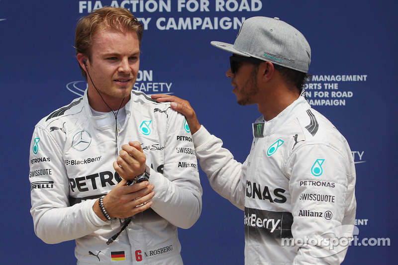 (L to R): Nico Rosberg, Mercedes AMG F1 celebrates his pole position with team mate Lewis Hamilton, Mercedes AMG F1
