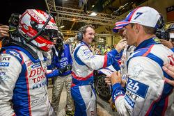 Pole winner Kazuki Nakajima celebrates with teammates Alexander Wurz and Stéphane Sarrazin