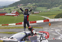 Winner Reinis Nitiss celebrates