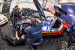 Black Falcon team members repair the damage on the #1 Black Falcon Mercedes-Benz SLS AMG GT3