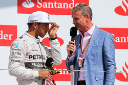 Race winner Lewis Hamilton, Mercedes AMG F1 on the podium with David Coulthard, Red Bull Racing and Scuderia Toro Advisor / BBC Television Commentator