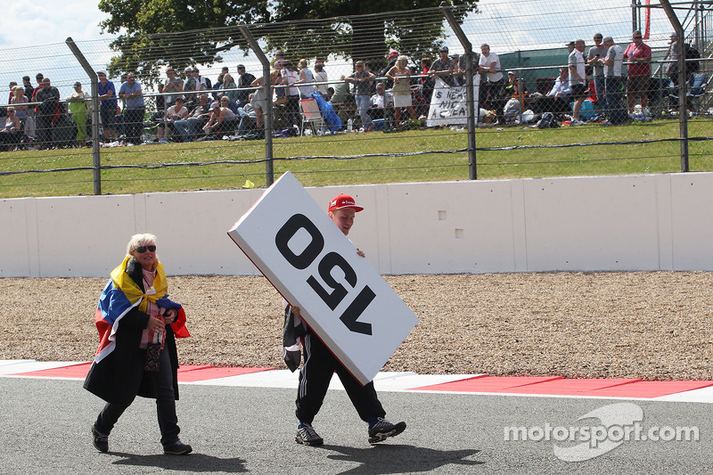 A fan with a souvenir brake marker board