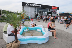 Fans cool off in an inflatable pool
