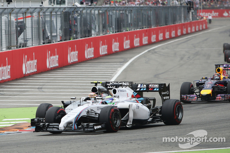 Felipe Massa, Williams FW36 and Kevin Magnussen, McLaren MP4-29 collide at the start of the race