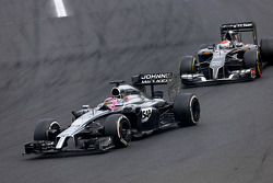 Jenson Button, McLaren F1 Team and Adrian Sutil, Sauber F1 Team
