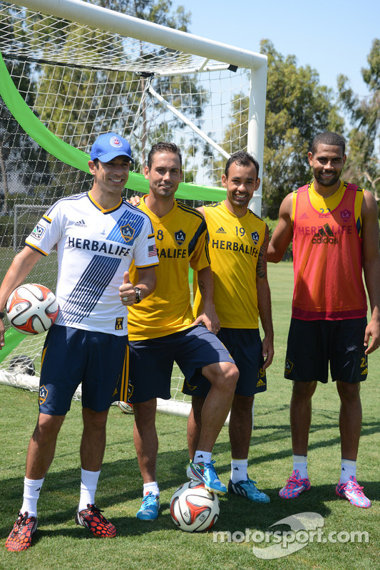 Helio Castroneves with LA Galaxy players during practice