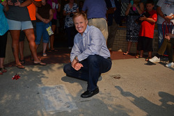 Rusty Wallace poses alongside his commemorative sidewalk plaque