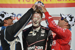 Race winner Will Power gets a face full of cream puff from second place Juan Pablo Montoya and third place Tony Kanaan