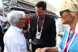 (L to R): Bernie Ecclestone, with  Keanu Reeves, Actor and Pamela Anderson, Actress on the grid