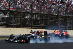 Adrian Sutil, Sauber C33 and Sebastian Vettel, Red Bull Racing RB10