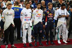 (L to R): Nico Hulkenberg, Sahara Force India F1; Jenson Button, McLaren; Daniel Ricciardo, Red Bull Racing; Sebastian Vettel, Red Bull Racing; and Lewis Hamilton, Mercedes AMG F1 observe the anthem on the grid