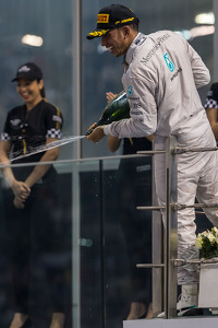 (L to R): Race winner and World Champion Lewis Hamilton, Mercedes AMG F1 celebrates on the podium