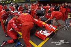 Michael Schumacher and Rubens Barrichello try their hands at a pitstop