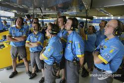 Renault F1 team members watch qualifying