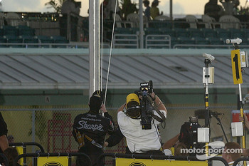 '2004 NASCAR NEXTEL Cup champion Kurt Busch raises the champion's flag