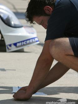 Crew member prepares pit area