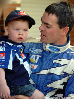 Craig Lowndes and son Levi after grabbing 3rd spot on the grid
