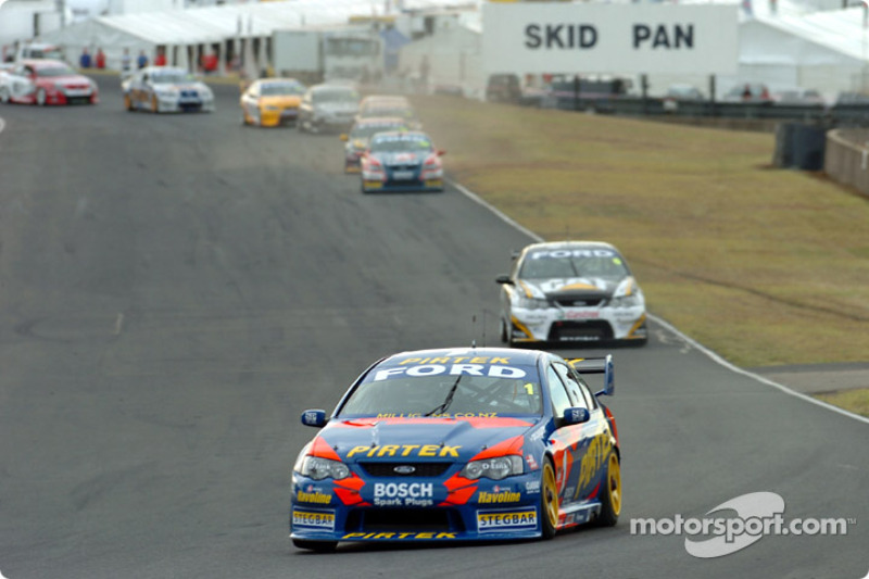 Marcos Ambrose out in front with Craig Lowndes the only threat