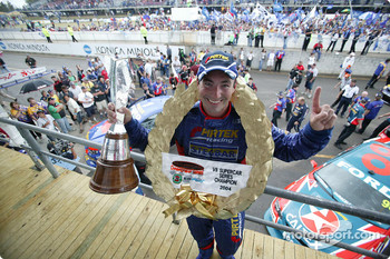 Podium: Australian V8 Supercar Series 2004 champion Marcos Ambrose celebrates