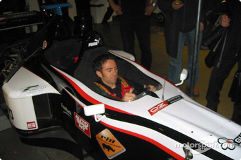 The 2001 and 2003 Giro d' Italia winner, Gilberto Simoni, in the Minardi F1X2 car