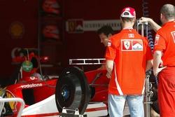 Michael Schumacher inspects the new Ferrari F2005
