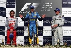Podium: race winner Fernando Alonso with Jarno Trulli and Kimi Raikkonen