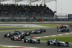 First corner: Mark Webber and Nick Heidfeld lead the rest of the field