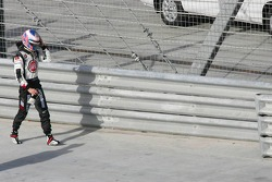 Jenson Button walks back to the pits after his abandon