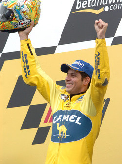Podium: race winner Alex Barros celebrates