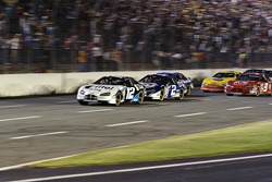 Ryan Newman leads the pack at the start
