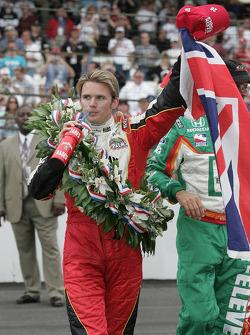 Race winner Dan Wheldon celebrates