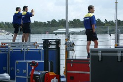 Michelin crew members watch qualifying