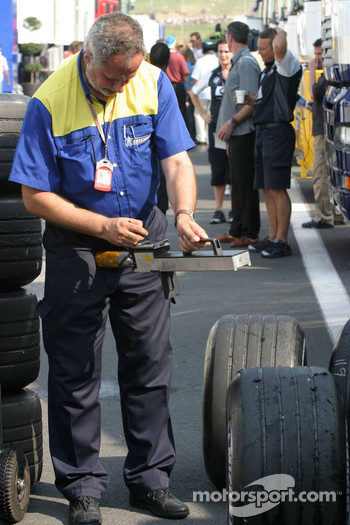 Michelin engineer checks tires