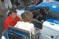 MDA kids inspect No. 20 MDA car