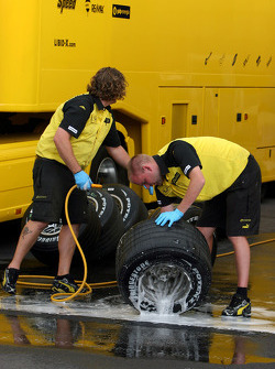 Jordan team members wash wheels