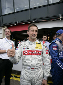 Pole winner Bernd Schneider celebrates