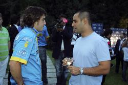 Juan Pablo Montoya talks with Fernando Alonso