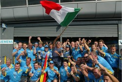 Fernando Alonso and Giancarlo Fisichella celebrate with Flavio Briatore and Renault F1 team members