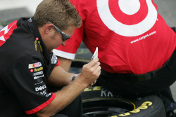 Texaco Dodge crew member prepares wheels