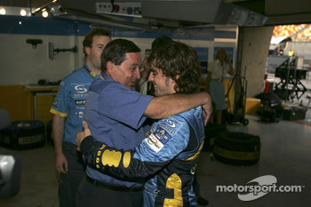 Fernando Alonso celebrates with Patrick Faure