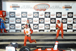 Podium: champagne for Sébastien Bourdais, Oriol Servia and Jimmy Vasser